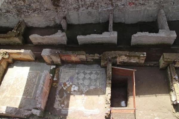 A view of ancient roman ruins and mosaics discovered during work on a new underground line, in Rome, Monday, May 16, 2016. Work on the Metro C being built through the center of Rome has once again run into ancient roman ruins, this time the barracks for the Roman Praetorian guards dating back to the period of Emperor Hadrian, in the second century A.D. Officials say the barracks cover 900 square meters, and include a 100 meter hallway with 39 rooms. ANSA/PAOLA MENTUCCIA